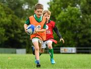 18 August 2018; Irish Rugby Captain and Glenisk ambassador Rory Best is pictured at an exclusive Glenisk Rugby Training Camp in De La Salle RFC with 100 lucky competition winners aged between 7 and 12 years. The camp, hosted by Glenisk, Official Yoghurt of Irish Rugby, was designed to encourage children to make new friends, develop their rugby skills and learn about the best foods for their growing bodies with advice from IRFU Performance Nutritionist Marcus Shortall. Pictured at the event is young players Leon Egan, left, age 7 from Navan, Meath in action against JJ Barry, age 8 from Limerick during the camp at De La Salle Palmerstown RFC, Dublin. Photo by Eóin Noonan/Sportsfile