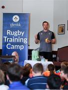 18 August 2018; Irish Rugby Captain and Glenisk ambassador Rory Best is pictured at an exclusive Glenisk Rugby Training Camp in De La Salle RFC with 100 lucky competition winners aged between 7 and 12 years. The camp, hosted by Glenisk, Official Yoghurt of Irish Rugby, was designed to encourage children to make new friends, develop their rugby skills and learn about the best foods for their growing bodies with advice from IRFU Performance Nutritionist Marcus Shortall. Pictured at the event is IRFU Performance Nutritionist Marcus Shortall speaking to young players ahead of the camp at De La Salle Palmerstown RFC, Dublin. Photo by Eóin Noonan/Sportsfile