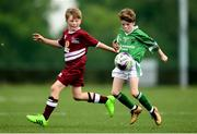 18 August 2018; James Hagan of Clonguish, Co. Longford, in action against Trent Slattery of Clarinbridge, Co. Galway, competing in the Soccer Outdoor U12 Final event during day one of the Aldi Community Games August Festival at the University of Limerick in Limerick. Photo by Harry Murphy/Sportsfile