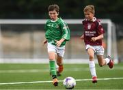 18 August 2018; Cian McConnell of St Patricks, Co. Cavan, in action against Darragh Ball of Doora Barefield, Co. Clare, during the Soccer Outdoor U12 & O8 Boys event during day one of the Aldi Community Games August Festival at the University of Limerick in Limerick. Photo by Sam Barnes/Sportsfile