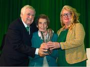 17 August 2018; Paddy Melia and Jeannie Frampton, right, accept a John Sherlock Services to Football Award on behalf of the late Adrian Melia, Kildare sports photographer, from FAI President Tony Fitzgerald at the FAI Delegates Dinner & FAI Communications Awards at the Rochestown Park Hotel in Cork. Photo by Stephen McCarthy/Sportsfile
