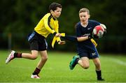19 August 2018; Conor O'Neill of Monaghan Town, Co. Monaghan, in action against Tomas McCabe of Rosses Point, Co. Sligo, competing in the Rugby Tag U11 event during day two of the Aldi Community Games August Festival at the University of Limerick in Limerick. Photo by Harry Murphy/Sportsfile