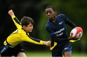 19 August 2018; Daniel Alex of Monaghan Town, Co. Monaghan, in action against John Paul Flanagan of Rosses Point, Co. Sligo, competing in the Rugby Tag U11 event during day two of the Aldi Community Games August Festival at the University of Limerick in Limerick. Photo by Harry Murphy/Sportsfile