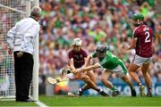 19 August 2018; Graeme Mulcahy of Limerick scores his side's first goal despite the efforts of Daithí Burke of Galway during the GAA Hurling All-Ireland Senior Championship Final match between Galway and Limerick at Croke Park in Dublin. Photo by Eóin Noonan/Sportsfile