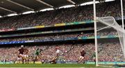 19 August 2018; Graeme Mulcahy of Limerick strikes the sliotar past Galway goalkeeper James Skehill on his way to scoring his side's first goal during the GAA Hurling All-Ireland Senior Championship Final match between Galway and Limerick at Croke Park in Dublin. Photo by Ramsey Cardy/Sportsfile