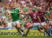 19 August 2018; Tom Morrissey of Limerick flicks the sliothar past Adrian Tuohy of Galway to score his side's second goal in the 54th minute of the GAA Hurling All-Ireland Senior Championship Final match between Galway and Limerick at Croke Park in Dublin.  Photo by Ray McManus/Sportsfile