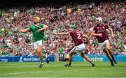 19 August 2018; Tom Morrissey of Limerick evades the tackle of Adrian Tuohy of Galway on his way to scoring his side's second goal during the GAA Hurling All-Ireland Senior Championship Final match between Galway and Limerick at Croke Park in Dublin. Photo by Seb Daly/Sportsfile