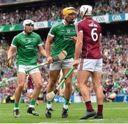 19 August 2018; Tom Morrissey of Limerick celebrates in front of Gearóid McInerney of Galway after scoring his side's second goal during the GAA Hurling All-Ireland Senior Championship Final match between Galway and Limerick at Croke Park in Dublin. Photo by Seb Daly/Sportsfile