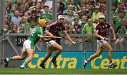 19 August 2018;Tom Morrissey of Limerick scores his side's second goal as Gearóid McInerney, centre, and Daithí Burke of Galway close in during the GAA Hurling All-Ireland Senior Championship Final match between Galway and Limerick at Croke Park in Dublin.  Photo by Piaras Ó Mídheach/Sportsfile