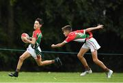 19 August 2018; Dannan Fox of Quin - Clooney, Co. Clare, in action against Conor Sleerin of Milltown, Co. Kildare competing in the Rugby Tag U14 event during day two of the Aldi Community Games August Festival at the University of Limerick in Limerick. Photo by Harry Murphy/Sportsfile