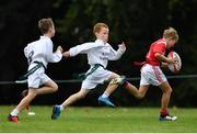 19 August 2018; Conor Scanlon and Tadgh Scanlon of St Brigids Newbridge, Co. Kildare, in action against Jack Dervan, Co. Limerick, as they compete in the Rugby Tag U11 event during day two of the Aldi Community Games August Festival at the University of Limerick in Limerick. Photo by Harry Murphy/Sportsfile