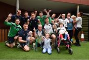 20 August 2018; Members of the Limerick squad and their manager John Kiely join children and staff for a photograph with the Liam MacCarthy Cup during the All-Ireland Senior Hurling Championship winners visit to Our Lady's Children's Hospital Crumlin, Dublin. Photo by Piaras Ó Mídheach/Sportsfile