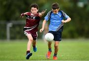 19 August 2018; Gus Lohan of Oranmore, Co. Galway in action against Liam Keane of Ballynacally-Lissycasey, Co. Clare competing in the Gaelic Football U10 Final event during day two of the Aldi Community Games August Festival at the University of Limerick in Limerick. Photo by Harry Murphy/Sportsfile