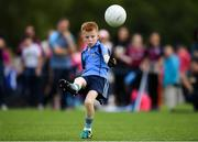 19 August 2018; Ryan Holland of Oranmore, Co. Galway competing in the Gaelic Football U10 Final event during day two of the Aldi Community Games August Festival at the University of Limerick in Limerick. Photo by Harry Murphy/Sportsfile
