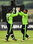 20 August 2018; Gary Wilson, left, and Simi Singh of Ireland celebrate after claiming the wicket Hazratullah Zazai of Afghanistan during the T20 International cricket match between Ireland and Afghanistan at Bready Cricket Club, in Magheramason, Co. Tyrone. Photo by Seb Daly/Sportsfile