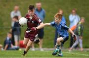 19 August 2018; Josh Marrinan of Ballynacally-Lissycasey, Co. Clare, in action against Ryan Holland of Oranmore, Co. Galway, during the Boys U10 & O7 Gaelic Football event during day two of the Aldi Community Games August Festival at the University of Limerick in Limerick. Photo by Sam Barnes/Sportsfile