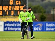 20 August 2018; Simi Singh of Ireland, right, celebrates with team-mate Gary Wilson after running-out Mohammad Shahzad of Afghanistan during the T20 International cricket match between Ireland and Afghanistan at Bready Cricket Club, in Magheramason, Co. Tyrone. Photo by Seb Daly/Sportsfile
