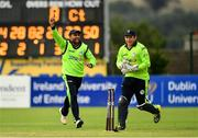 20 August 2018; Simi Singh of Ireland, left, celebrates with team-mate Gary Wilson after running-out Mohammad Shahzad of Afghanistan during the T20 International cricket match between Ireland and Afghanistan at Bready Cricket Club, in Magheramason, Co. Tyrone. Photo by Seb Daly/Sportsfile