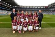 19 August 2018; Mini-games co-ordinator Gerry O'Meara, with the Galway team, back row, left to right, Muireann Ní Riocaird, St Fiachra's SNS, Beaumont, Co Dublin, Ciara Connolly, Aughrim NS, Aughrim, Co Wicklow, Sarah May Walsh, Ballyfacey NS, Ballyfacey, Co Kilkenny, Jane Murray, Killeigh NS, Killeigh, Co Offaly, Katelyn Shore, Paddock NS, Mountrath, Co Laois, front row, left to right, Kate Ní Riain, Gaelscoil Eiscir Riada Leamhchán, Co Dublin, Lucy Devaney, Holy Rosary PS, Old Court, Firhouse, Co Dublin, Ciara Ryan, Mercy Convent NS, Naas, Co Kildare, Ellen Hawes, Stonepark NS, Stonepark, Co Longford, Caoimhe Kelly, Scoil Bhríde, Ballinasloe, Co Galway, ahead of the INTO Cumann na mBunscol GAA Respect Exhibition Go Games the GAA Hurling All-Ireland Senior Championship Final match between Galway and Limerick at Croke Park in Dublin. Photo by Daire Brennan/Sportsfile