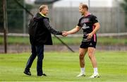 21 August 2018; Ireland Head Coach Joe Schmidt meets Ulster Rugby's new centre Will Addison during Ulster Rugby training at Pirrie Park, in Belfast. Photo by John Dickson/Sportsfile