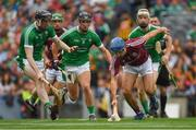 19 August 2018; Johnny Coen of Galway in action against Limerick players, from left, Declan Hannon, Darragh O'Donovan and Cian Lynch during the GAA Hurling All-Ireland Senior Championship Final match between Galway and Limerick at Croke Park in Dublin.  Photo by Piaras Ó Mídheach/Sportsfile