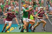 19 August 2018; Tom Morrissey of Limerick on his way to scoring his side's second goal as Galway players, from left, Adrian Tuohy, Gearóid McInerney and Daithí Burke close in during the GAA Hurling All-Ireland Senior Championship Final match between Galway and Limerick at Croke Park in Dublin.  Photo by Piaras Ó Mídheach/Sportsfile