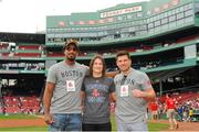 23 August 2018; WBA & IBF World Lightweight Champion Katie Taylor with boxers Demetrius Andrade, left, and Mark de Luca on a visit to Fenway Park ahead of the Major League Baseball regular season game between Boston Red Sox and Cleveland Indians at Fenway Park in Boston, USA. Photo by Emily Harney/Matchroom Boxing USA via Sportsfile