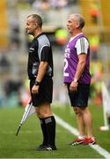 12 August 2018; Linesman Brendan Cawley and Pat McEnaney, Monaghan backroom team and brother of Monaghan manager Séamus McEnaney, look on during the Electric Ireland GAA Football All-Ireland Minor Championship semi-final match between Kerry and Monaghan at Croke Park in Dublin. Photo by Piaras Ó Mídheach/Sportsfile