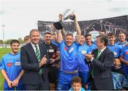 25 August 2018; North End United captain Paul Murphy lifts the cup after it was presented by President of the Junior IFA Committee, Maurice Johnston, left, and President of the FAI, Donal Conway, right, after the President's Junior Cup Final match between North End United and Enniskillen Rangers at Home Farm FC in Whitehall, Dublin Photo by Matt Browne/Sportsfile