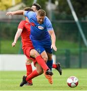 25 August 2018; Paul Murphy of North End United in action against Ciaran Smith of Enniskillen Rangers during the President's Junior Cup Final match between North End United and Enniskillen Rangers at Home Farm FC in Whitehall, Dublin Photo by Matt Browne/Sportsfile