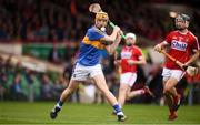 26 August 2018; Jake Morris of Tipperary scores an early point despite the attentions of Mark Coleman of Cork during the Bord Gais Energy GAA Hurling All-Ireland U21 Championship Final match between Cork and Tipperary at the Gaelic Grounds in Limerick. Photo by Sam Barnes/Sportsfile