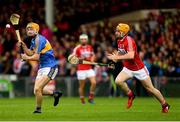 26 August 2018; Jake Morris of Tipperary in action against Niall O'Leary of Cork during the Bord Gais Energy GAA Hurling All-Ireland U21 Championship Final match between Cork and Tipperary at the Gaelic Grounds in Limerick. Photo by Piaras Ó Mídheach/Sportsfile