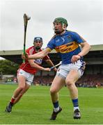 26 August 2018; Brian McGrath of Tipperary in action against Liam Healy of Cork during the Bord Gais Energy GAA Hurling All-Ireland U21 Championship Final match between Cork and Tipperary at the Gaelic Grounds in Limerick. Photo by Piaras Ó Mídheach/Sportsfile