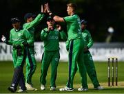 27 August 2018; Boyd Rankin of Ireland, right, is congratulated by team-mates after claiming the wicket of Hazratullah Zazai of Afghanistan during the One Day International match between Ireland and Afghanistan at Stormont Cricket Ground, Belfast, Co. Antrim. Photo by Seb Daly/Sportsfile