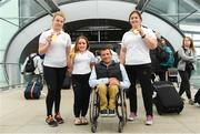 27 August 2018; John Fulham, President of Paralympics Ireland, with Team Ireland medallists, from left, Noelle Lenihan, Niamh McCarthy, and Orla Barry as they return to Dublin from the 2018 World Para Athletics European Championships at Dublin Airport in Dublin. Photo by Sam Barnes/Sportsfile