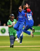 27 August 2018; Aftab Alam of Afghanistan, facing, celebrates with team-mate Hashmatullah Shaidi after claiming the wicket of Paul Stirling of Ireland during the One Day International match between Ireland and Afghanistan at Stormont Cricket Ground, Belfast, Co. Antrim. Photo by Seb Daly/Sportsfile