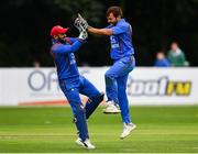 27 August 2018; Gulbadin Naib of Afghanistan celebrates with team-mate Shafiqullah Shafaq after claiming the wicket of William Porterfield of Ireland during the One Day International match between Ireland and Afghanistan at Stormont Cricket Ground, Belfast, Co. Antrim. Photo by Seb Daly/Sportsfile
