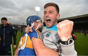 26 August 2018; Former Tipperary senior hurler Shane McGrath celebrates with David Gleeson of Tipperary after the Bord Gais Energy GAA Hurling All-Ireland U21 Championship Final match between Cork and Tipperary at the Gaelic Grounds in Limerick. Photo by Piaras Ó Mídheach/Sportsfile