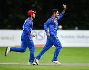 27 August 2018; Najibullah Zadran of Afghanistan, right, celebrates after catching Andy McBrine of Ireland during the One Day International match between Ireland and Afghanistan at Stormont Cricket Ground, Belfast, Co. Antrim. Photo by Seb Daly/Sportsfile