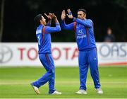 27 August 2018; Najibullah Zadran, left, and Mohammad Nabi of Afghanistan congratulate each other after claiming the wicket of Andy McBrine of Ireland during the One Day International match between Ireland and Afghanistan at Stormont Cricket Ground, Belfast, Co. Antrim. Photo by Seb Daly/Sportsfile