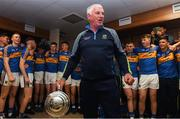 26 August 2018; Tipperary selector John Sheedy celebrates with the James Nowlan Cup with the players in the dressing room after the Bord Gais Energy GAA Hurling All-Ireland U21 Championship Final match between Cork and Tipperary at the Gaelic Grounds in Limerick. Photo by Piaras Ó Mídheach/Sportsfile