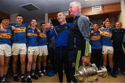 26 August 2018; Tipperary manager Liam Cahill, left, and selector John Sheedy celebrate with the the James Nowlan Cup with their players in the dressing room after the Bord Gais Energy GAA Hurling All-Ireland U21 Championship Final match between Cork and Tipperary at the Gaelic Grounds in Limerick. Photo by Piaras Ó Mídheach/Sportsfile