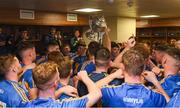26 August 2018; Tipperary players celebrate in the dressing room with the James Nowlan Cup after the Bord Gais Energy GAA Hurling All-Ireland U21 Championship Final match between Cork and Tipperary at the Gaelic Grounds in Limerick. Photo by Piaras Ó Mídheach/Sportsfile