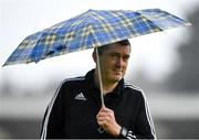 31 August 2018; Assistant referee Ciaran Delaney walks the pitch under the shelter of an umbrella ahead of the SSE Airtricity League Premier Division match between Cork City and Sligo Rovers at Turner's Cross in Cork. Photo by Eóin Noonan/Sportsfile