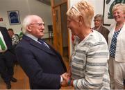 31 August 2018; The President of Ireland Michael D Higgins meets Paula Gorham, a member of the Dundalk Ladies football team who represented Ireland in a match against Corinthian Nomads of England, played in Wales in 1968, at half-time of the 2019 FIFA Women's World Cup Qualifier match between Republic of Ireland and Northern Ireland at Tallaght Stadium in Dublin. Photo by Stephen McCarthy/Sportsfile