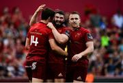 1 September 2018; Darren Sweetnam of Munster, left, is congratulated by team-mates Sam Arnold and Rory Scannell after scoring his side's sixth try during the Guinness PRO14 Round 1 match between Munster and Toyota Cheetahs at Thomond Park in Limerick. Photo by Diarmuid Greene/Sportsfile