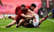 1 September 2018; Malcolm Jaer of Toyota Cheetahs is tackled by JJ Hanrahan, Sam Arnold, and Joey Carbery of Munster during the Guinness PRO14 Round 1 match between Munster and Toyota Cheetahs at Thomond Park in Limerick. Photo by Diarmuid Greene/Sportsfile