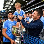 2 September 2018; Cian O'Sullivan of Dublin with 2 year old  Liam McManamon, nephew of Dublin player Kevin, followng the GAA Football All-Ireland Senior Championship Final match between Dublin and Tyrone at Croke Park in Dublin. Photo by Ramsey Cardy/Sportsfile