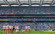 2 September 2018; The Tyrone team sit on the pitch during the presentation after the GAA Football All-Ireland Senior Championship Final match between Dublin and Tyrone at Croke Park in Dublin. Photo by Brendan Moran/Sportsfile