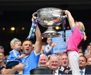 2 September 2018; Eoghan O'Gara of Dublin lifts the Sam Maguire Cup with his daughters Fiadh and Ella following the GAA Football All-Ireland Senior Championship Final match between Dublin and Tyrone at Croke Park in Dublin. Photo by Seb Daly/Sportsfile